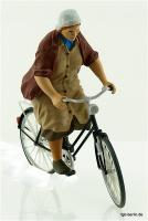Bäuerin auf Fahrrad (Lady farmer on bicycle)
